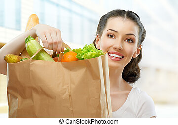 bag of food - girl holding a bag of food