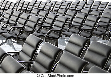 Empty Conference Hall or Waiting Space with black chairs