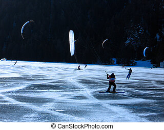 kitesurf - Snowkiting on a frozen lake - winter extreme...