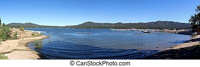 Big Bear Lake - Panorama view of Big Bear Lake with blue...