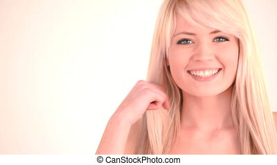 Attractive blond-haired woman posin