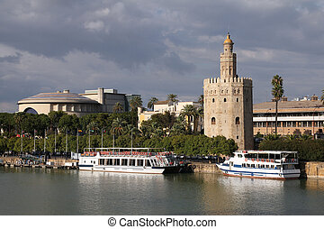 Seville, Spain - river Guadalquivir view with famous Golden...