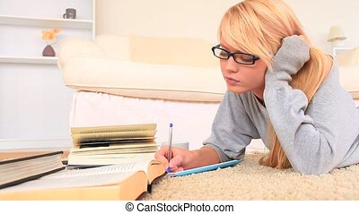 Young blond-haired woman studying