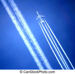 pursuer - a large jet flies parallel to a vaportrail in the...