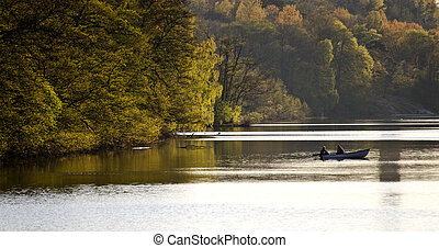 rowing boat - two people in a rowing boat on a lake