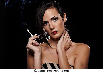 Smoking - Elegant brunette woman smoking a cigarette on...