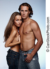 Jeans couple - Young couple in blue jeans on blue background