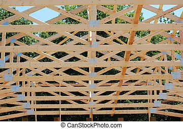 Trusses from a pole barn under construction
