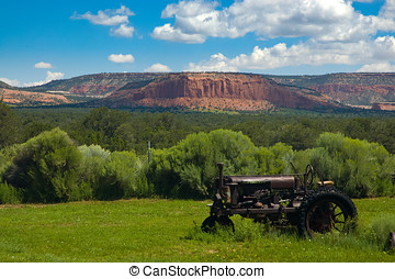 Old tractor in an Arizona field - An old tractor left in a...
