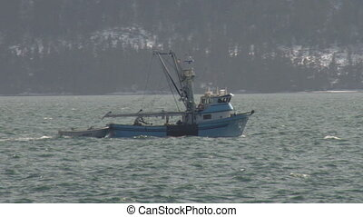 Fishing Boat and Dinghy 3 - Fishing boat heading out in...