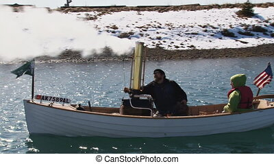 Steam Boat 4 - Small antique steam-powered boat maneuvering...