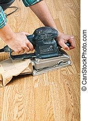 sander at work - detail of carpenter use sander on wood...