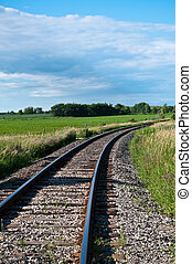 Railroad Tracks Curving Off into the Distance - Railroad...