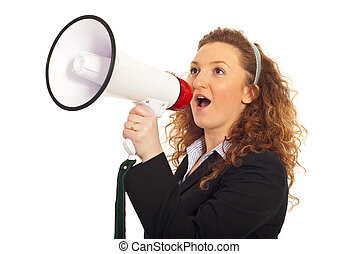 Business woman shouting into loudspeaker and standing in...