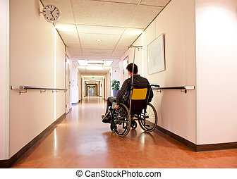 alone in hospital - man in wheel chair in empty hospital...
