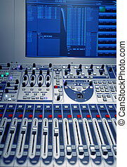 studio music mixer with computer screen