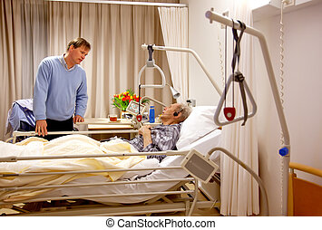 old man with visitor - visitor of recovery room by hospital