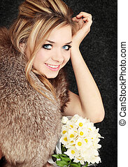 blond with the bouquet - young beautiful blond in the fur...
