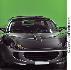 sport car with green background - detail of sport silver car...