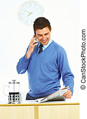 Man with newspaper and cell phone