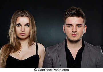 young couple standing next to each other