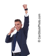 business man with mobile phone winning - happy business man...