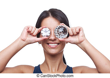 woman holding two crystals
