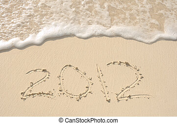 The Year 2012 Written in Sand on Beach - The Year 2012...
