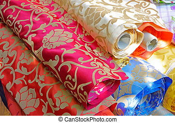 cloth - colorful cloths on the fabric market or a tailors