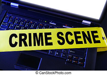 laptop with yellow crime scene tape across it