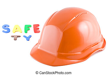 Protective helmet and letters on the white background. Safety.