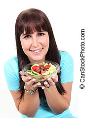 Woman holding a bowl with salad