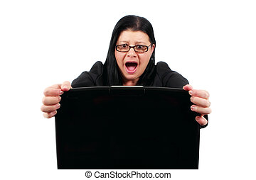 Computer disaster - Woman looking in disbelief at her laptop...