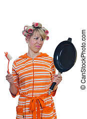 housewife with a brush and pan