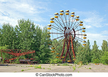 Abandoned ferris wheel in amusement park in Pripyat,...