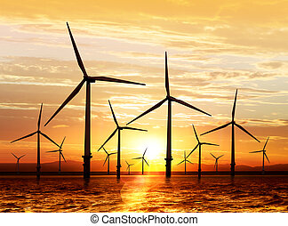 wind turbine on sunset - silhouette of wind turbine...