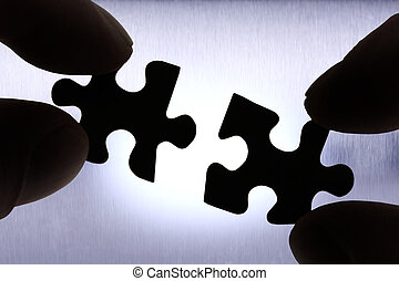 connect - two puzzle pieces getting connected