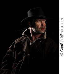 Man Tracker - Rugged Cowboy on horseback looking intensly