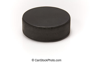 Hockey puck with reflection - A black hockey puck with a...