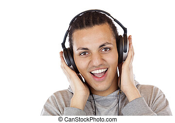 Happy young African man with headphones listens to mp3 music