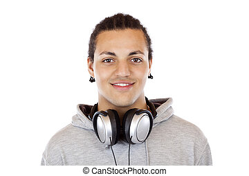 Portrait of a happy dark-skinned young man with headphones