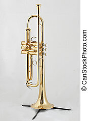 golden trumpet on a stand - gold lacquer trumpet with gold...