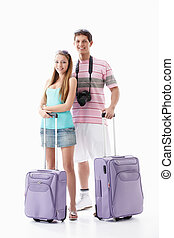 Travel - Young couple with suitcases on a white background