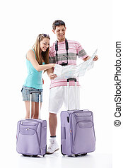 Tourists - Young couple with suitcases see map on a white...