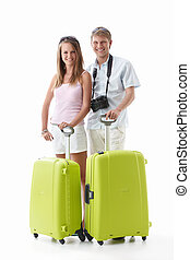 Tourists - An attractive couple with suitcases on a white...