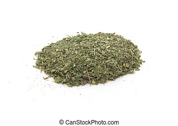 Pile of dried basil spice isolated