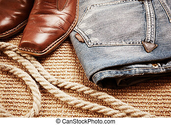 cowboy concept - leather boots and jeans, special toned ,...