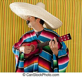 Mexican man serape poncho sombrero playing guitar typical...