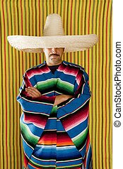 Mexican man typical poncho sombrero serape