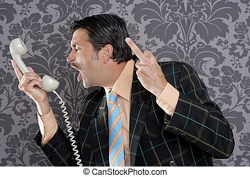 Angry nerd businessman retro telephone call shouting profile...